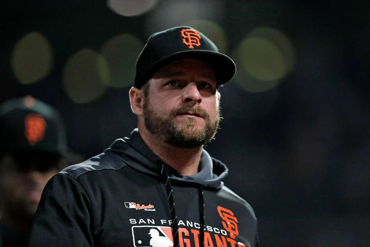 Stephen Vogt (21) walks back to the dugout after the San Francisco Giants defeated the Oakland Athletics at Oracle Park in San Francisco, Calif., on Tuesday, August 13, 2019.