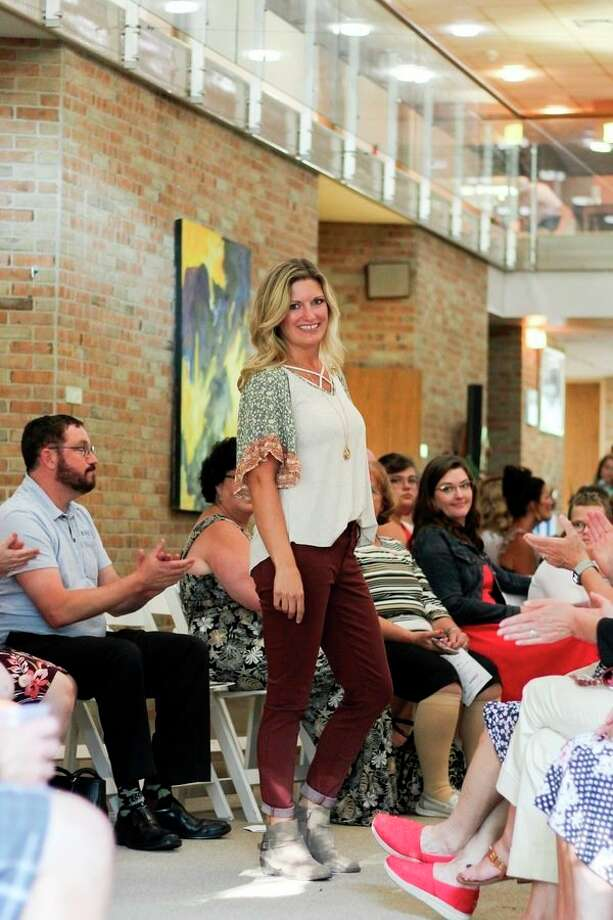 Volunteer models showcase the latest fashions at Family & Children Services' eighth annual fashion show. (Photo provided)