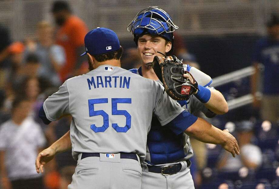 Russell Martin (55) and Will Smith celebrate a Dodgers win Tuesday in Miami. Photo: Mark Brown / Getty Images