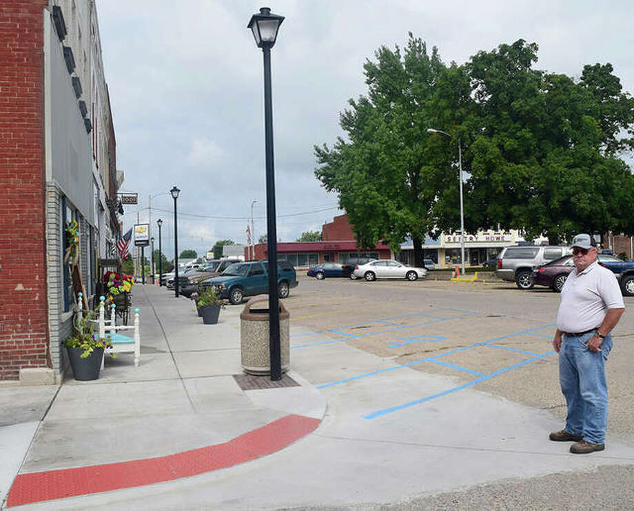 Winchester Mayor Rex McIntire shows off downtown Winchester's improvements to the sidewalk and as well as the new light poles. The sidewalks have been improved to meet the standards of the Americans with Disabilities Act. Photo: Marco Cartolano | Journal-Courier