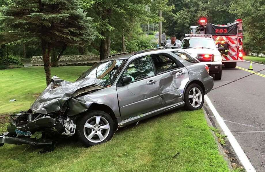 A collision sent two cars into a ditch in Monroe Tuesday evening. Photo: Contributed Photo / Monroe Fire Department