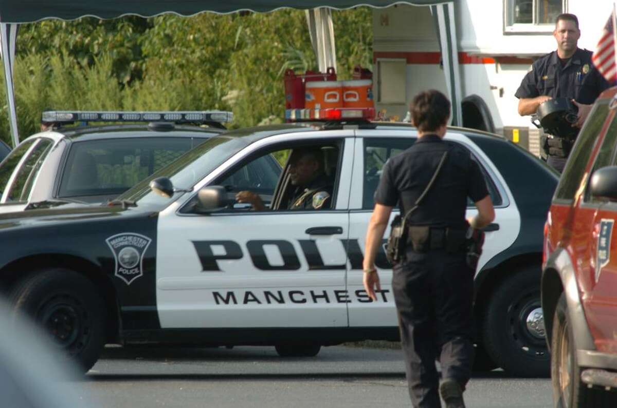 Police and investigators on the scene of a workplace shooting at a Budweiser distributor in Manchester, Conn. on Tuesday August 03, 2010.