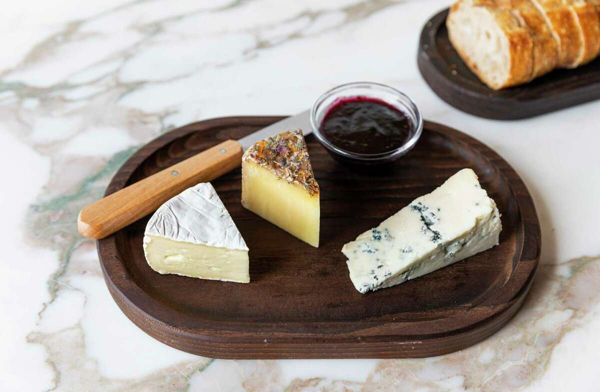 Left to right: Little Hosmer, from the Cellars at Jasper Hill, VT; Tiny Blossom, Nutty Alpine cheese covered in flowers from Austria; Andazul, Goats milk blue cheese from Spain at Montrose Cheese & Wine, a new cafe and retail shop from Goodnight Hospitality.