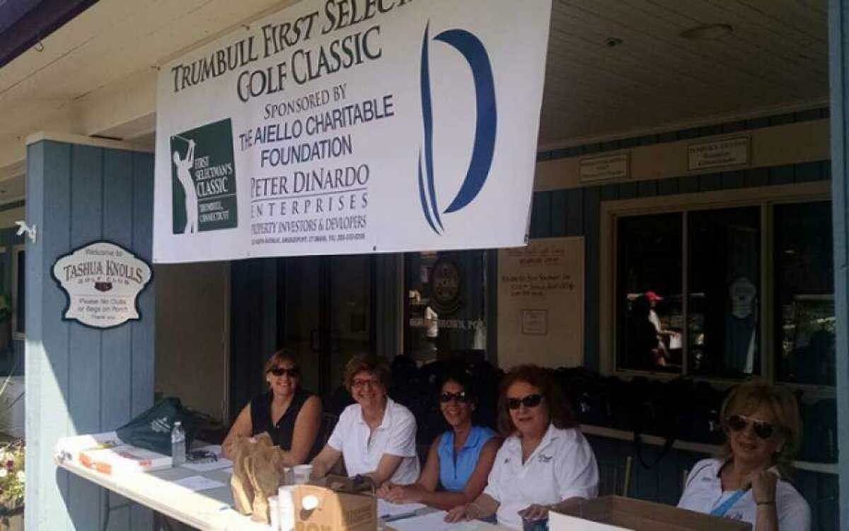 Barbara Whetstone and other volunteers register golfers at the 2016 First Selectman's Golf Classic.