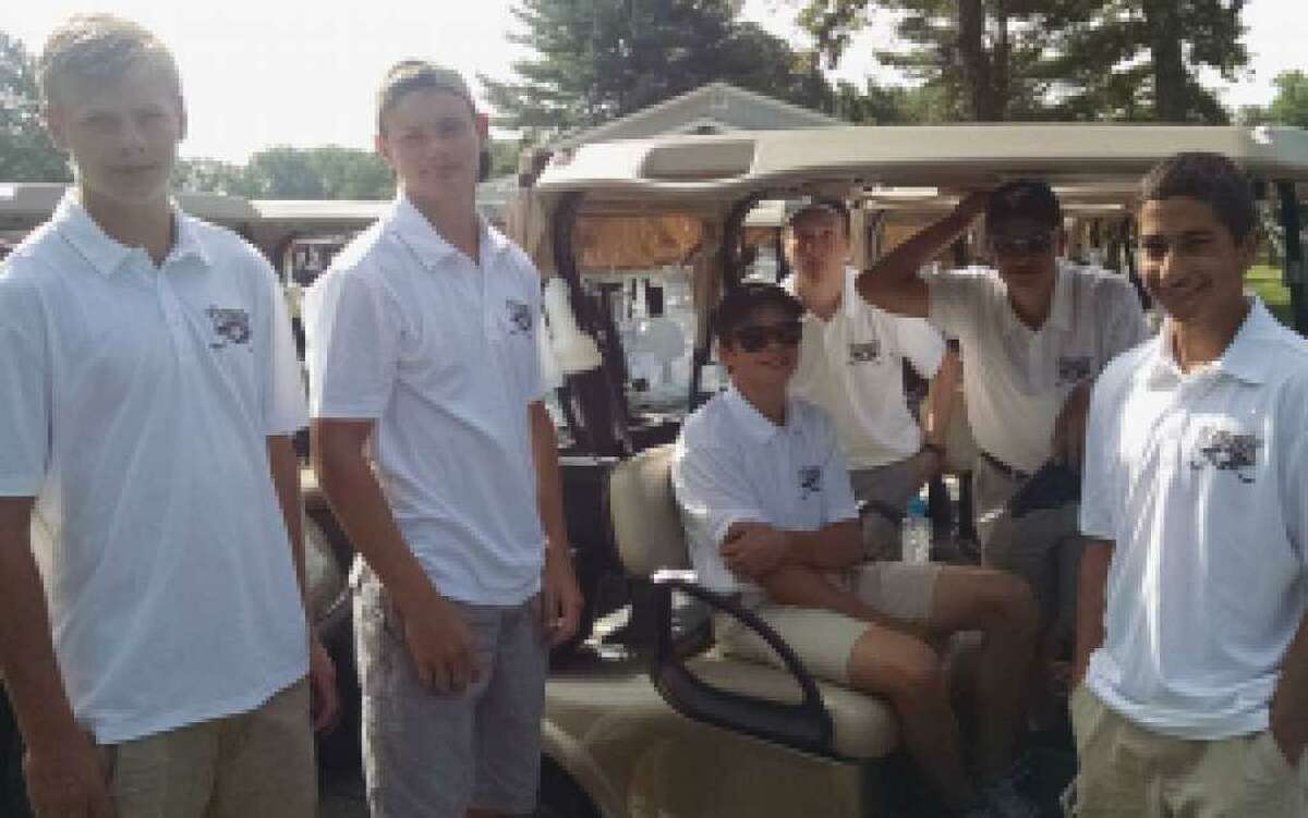 Trumbull High hockey players volunteer at the 2016 First Selectman's Golf Classic.