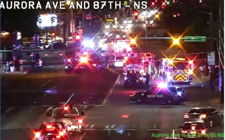 All lanes of Aurora Avenue North were closed for nearly five hours Tuesday night and Wednesday morning for an investigation after a van hit and killed a woman crossing the street. Photo: Courtesy SDOT