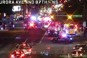 All lanes of Aurora Avenue North were closed for nearly five hours Tuesday night and Wednesday morning for an investigation after a van hit and killed a woman crossing the street.