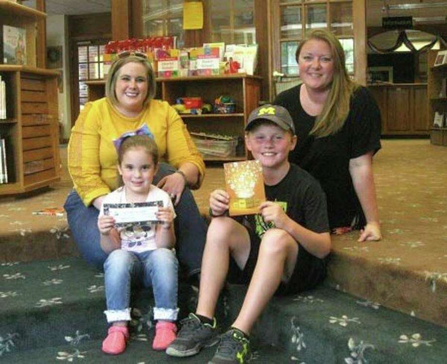 First place in the Parents As Reading Partners drawing was Baylee Stephan and her mom Becky Stephan (left). Second place in the drawing was Cody Palmer and his mom Denice Palmer (right). (Submitted Photo)