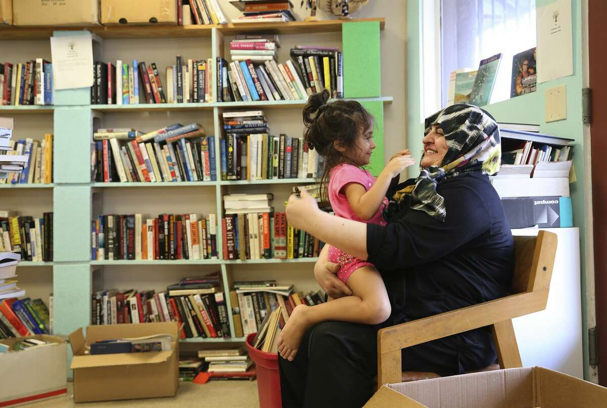 Halide Altikardes (right) plays with her granddaughter, Nil Oguz, at Dead Tree Books while Altikardes' son was shopping for books on Wednesday, Aug. 7, 2019. Dead Tree Books is the only bookstore on San Antonio's South Side and recently had put out an online plea for help to keep the business alive. Since then owners Lisa and Kenny Johnson have seen an uptick in walk-in traffic and online orders. The Johnson's started the bookstore in 2016 but the business has struggled to get customers. With the recent social media plea, people have come from all parts of town to patronize the bookstore and, for now, have staved off closure. (Kin Man Hui/San Antonio Express-News)