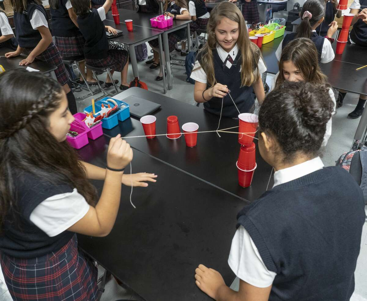 FILE PHOTO: Students in a STEM class use teamwork to build a tower made of cups 08/14/19 morning for the first day at the new Young Women's Leadership Academy. Tim Fischer/Reporter-Telegram