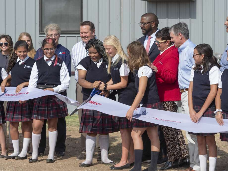 Students, faculty, administrators and XTO employees help cut the ribbon to open the YWLA  08/14/19 morning for the first day at the new Young Women's Leadership Academy. Tim Fischer/Reporter-Telegram Photo: Tim Fischer/Midland Reporter-Telegram