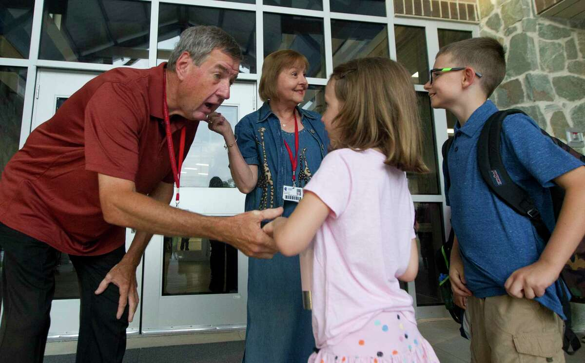 David and Sheree Suchma, namesakes of Suchma Elementary, visit with students on the first day of school for Conroe ISD, Wednesday, Aug. 14, 2019, in Conroe.