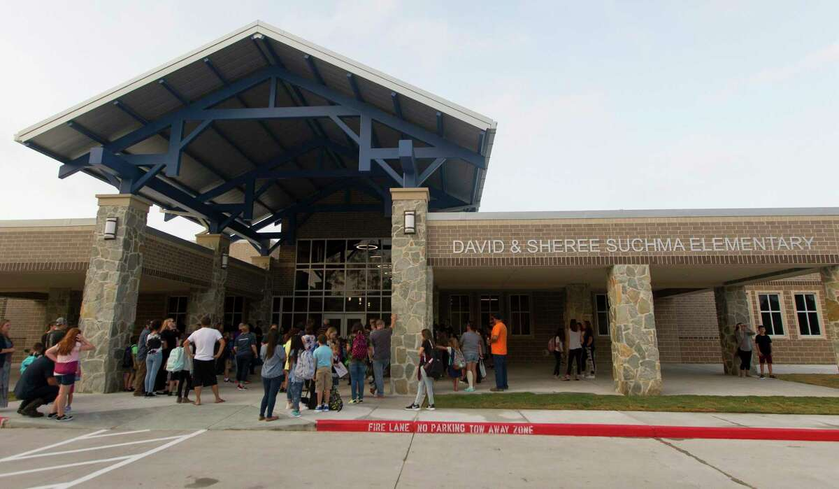 Students gather at the enterance to the newly built Suchma Elementary for the first day of school for Conroe ISD, Wednesday, Aug. 14, 2019, in Conroe.
