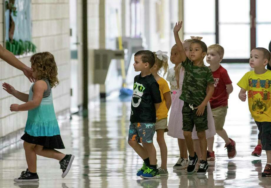 Children are led to their respective classrooms during the first day of school Wednesday, August 14, 2019 at CC Hardy Elementary School in Willis. Photo: Cody Bahn, Houston Chronicle / Staff Photographer / © 2019 Houston Chronicle