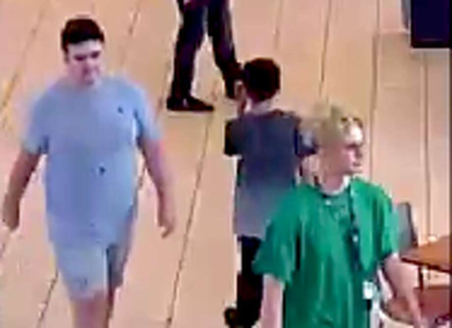 This frame grab taken from surveillance video shows two people, the person at left in a gray T-shirt, and the person at right, in the green T-shirt, who Houston Police want to question after an incident on Aug. 11, 2019, at Memorial City Mall that caused a panic. Photo: Houston Police Department