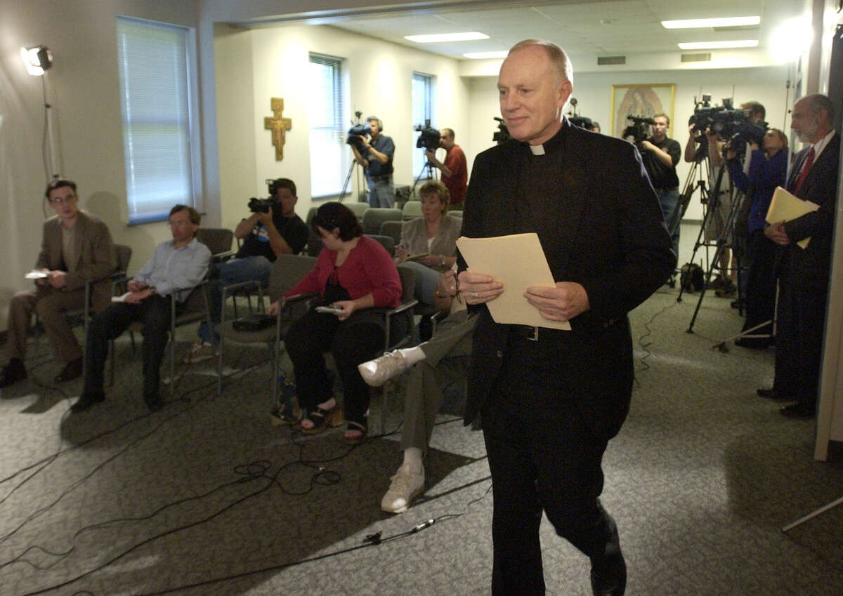 Bishop Howard Hubbard smiles as he enters his press conference Saturday at the Catholic Diocese Pastoral Center in Albany, June 26 2004. Hubbard spoke to the media for first time following Thursdays release of the Mary Jo White report. (TIMES UNION STAFF PHOTO WILL WALDRON)