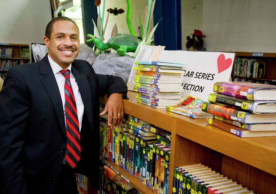 Northeast Elementary School Principal Hubert Gordon poses for a photo in the school in Stamford, Conn., on Thursday, August 14, 2014. Photo: Lindsay Perry / Lindsay Perry / Stamford Advocate
