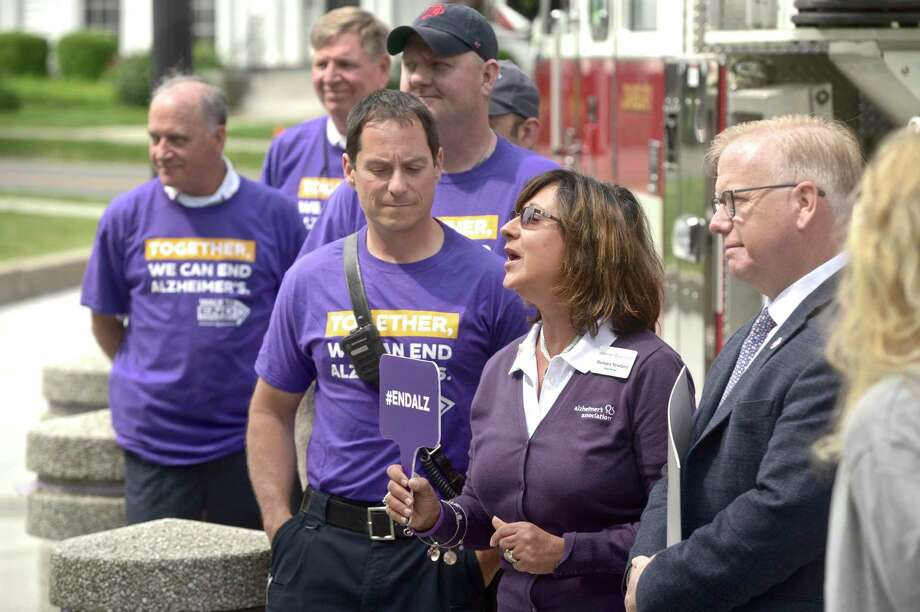 Barbara Newland, center, Walk Manager at the Alzheimer's Association, speaks during the kick off of Alzheimer's & Brain Awareness Month at City Hall, Wednesday morning, June 5, 2019, in Danbury, Conn. This years Walk to End Alzheimer's is September 22. Photo: H John Voorhees III / Hearst Connecticut Media / The News-Times