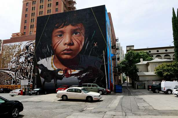 """Mural by Jorit Agoch is part of the art project """"Wide Open Walls"""" in downtown Sacramento, Ca., on Mon. August 5, 2019. This piece is at 1117 J St."""