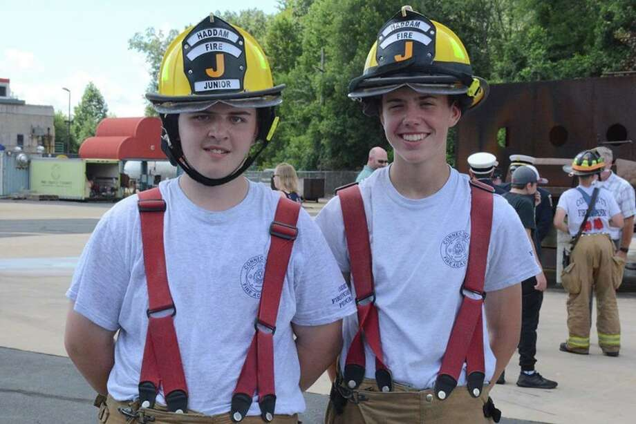 Haddam Volunteer Fire Company Junior Division members, from left, John Maziarz and Marc Perras completed the Introduction to the Fire Service course at the Connecticut Fire Academy Aug. 10. Photo: Olivia Drake Photo