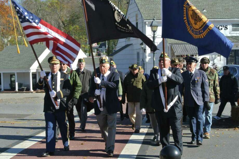 Representing American Legion Post 86, Ken Shewitz, left, marches in Wilton's Veterans Day parade with Alex Ruskewich, center, and Tom Moore. Photo: Jeannette Ross / Hearst Connecticut Media / Wilton Bulletin