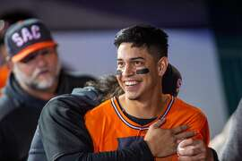 Sacramento River Cats Mauricio Dubon, jokes with teammates in the dugout as they play the Memphis Redbirds, Friday, August 9, 2019. Dubon came to the U.S. at age 15 to chase his baseball dreams and played at Capital Christian High School in Sacramento, then climbed through Red Sox/Brewers systems to become the on of the first players from Honduras to reach the majors. Photo Brian Baer