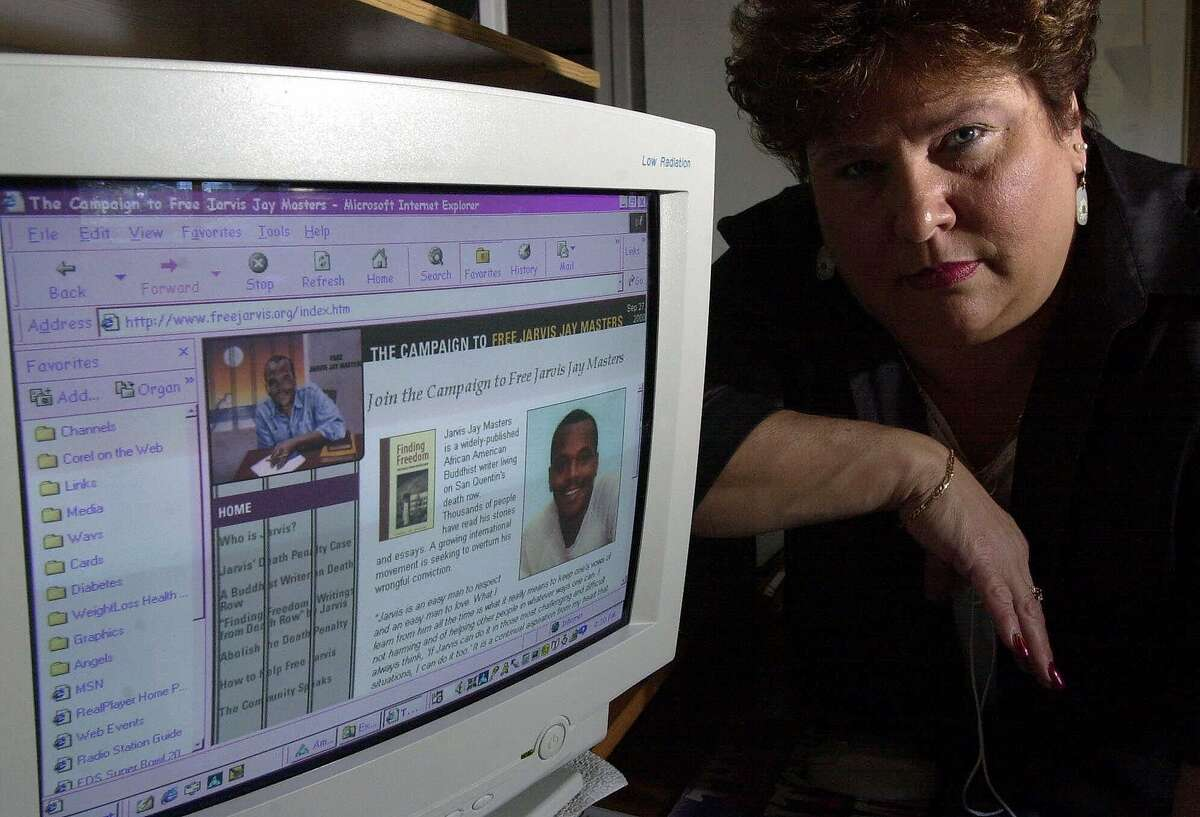 In this 2000 photo, Barbara Burchfield of Sacramento, Calif., displays the website of San Quentin inmate Jarvis Masters, who was sentenced to death after being convicted in the 1985 killing of her husband, a guard at the prison. Masters' sentence was upheld by the California Supreme Court this week, though two witnesses have recanted their testimony.