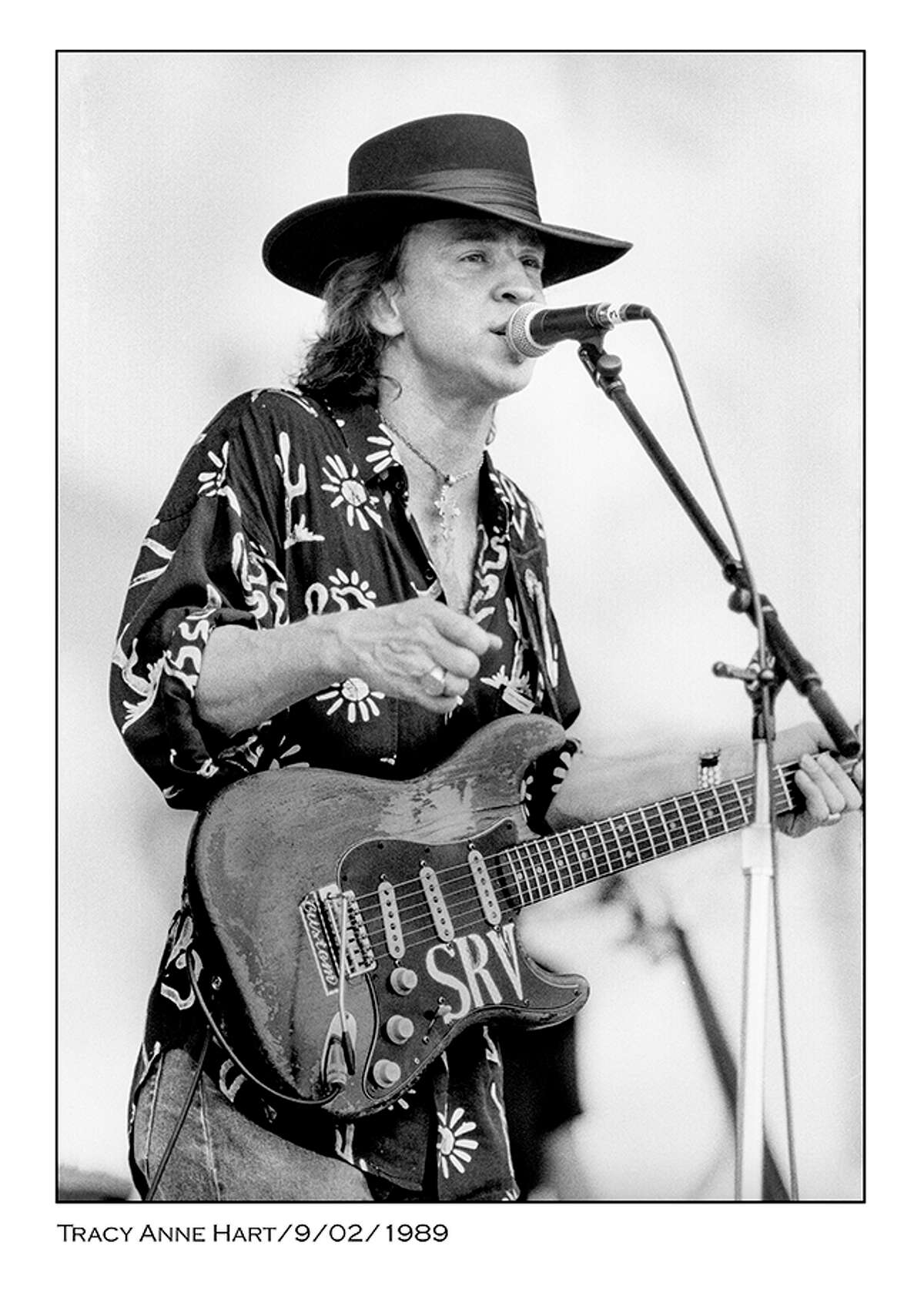 Photo of Stevie Ray Vaughan performing in the 1980s by Houston photographer Tracy Anne Hart.