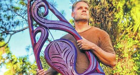 Jake Jones is the founder and artist behind Fresh Fish Gallery of Naples, Fla. Octopuses have become a favorite design for surfboard carvings.