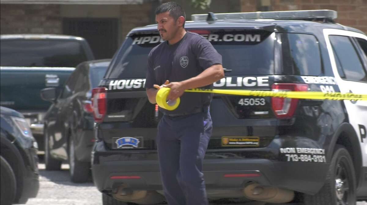 Houston police officers investigate a deadly auto-pedestrian collision inside the parking lot of a southeast Houston apartment complex Wednesday, Aug. 14, 2019.
