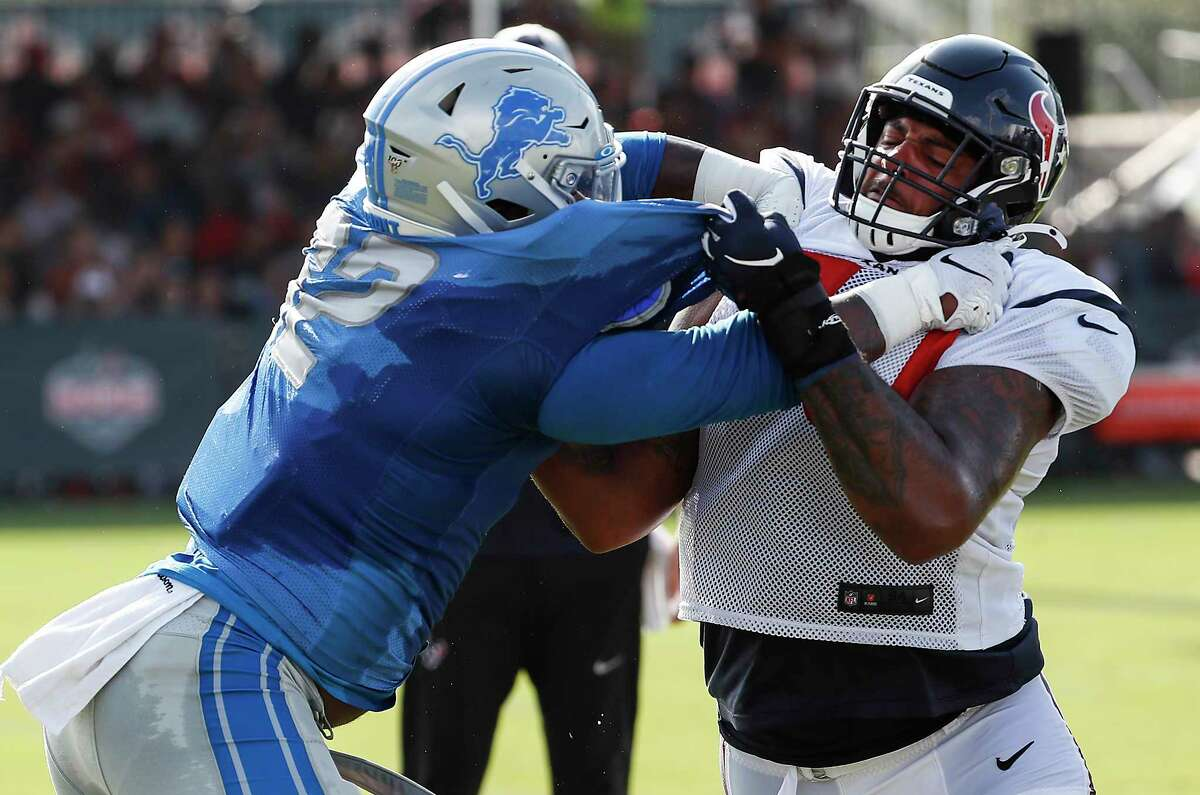 Detroit Lions defensive tackle P.J. Johnson (92) and Houston Texans offensive tackle Julie'n Davenport (70) go one-on-one during a joint training camp practice at the Houston Methodist Training Center on Wednesday, Aug. 14, 2019, inHouston..