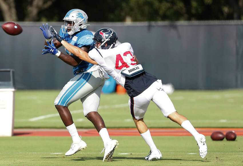Houston Texans safety Chris Johnson (43) breaks up a pass intended for Detroit Lions tight end Austin Traylor (87) during a joint training camp practice at the Houston Methodist Training Center on Wednesday, Aug. 14, 2019,inHouston.