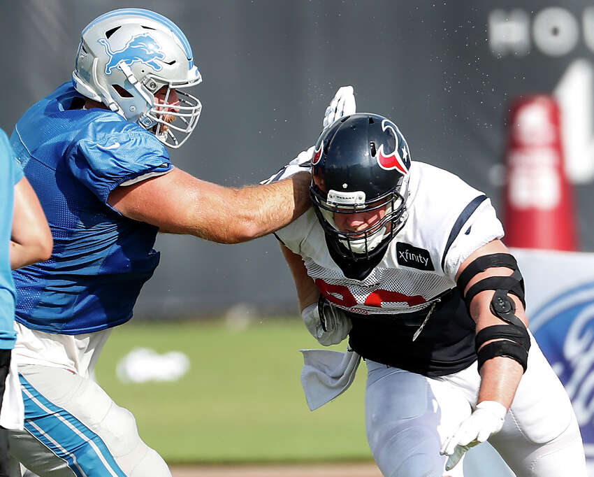 Houston Texans defensive end J.J. Watt (99) runs past Detroit Lions offensive tackle Rick Wagner (71) during a joint training camp practice at the Houston Methodist Training Center on Wednesday, Aug. 14, 2019,inHouston.