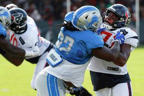 Detroit Lions defensive tackle P.J. Johnson (92) and Houston Texans offensive tackle Tytus Howard (71) go up against each other during a joint training camp practice at the Houston Methodist Training Center on Houston, Wednesday, Aug. 14, 2019.