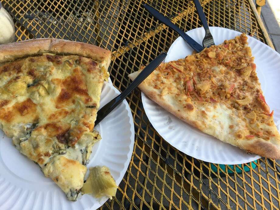 Slices of Artichoke Basille's pizza are so large they require two plates. Left: artichoke pizza; right: crab pizza. Photo: Photo By Jake P. On Yelp