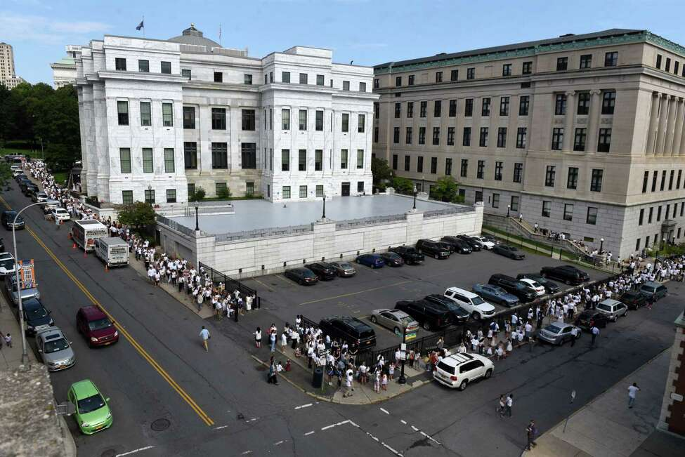 Anti-vaccination advocates stand in a line that stretched around the Albany County Courthouse where a judge heard oral arguments in a lawsuit that's seeking to overturn a new state law eliminating religious exemptions to school vaccination rules on Wednesday, Aug. 14, 2019, in Albany, N.Y. (Will Waldron/Times Union)