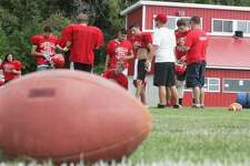 The Caseville Eagles run drills and perform stretching exercises during a morning practice on Wednesday.