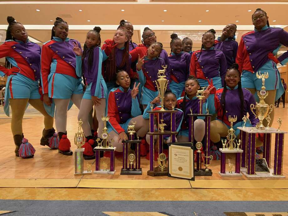 Members of New Haven's Nation Drill Squad & Drum Corps pose with their trophies. Photo: Contributed Photo