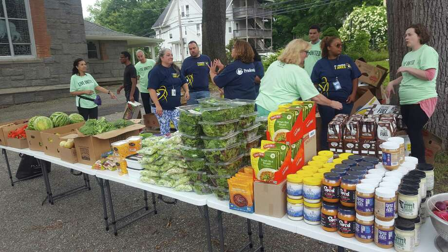Volunteers from Prudential, CT Basement Systems, and Good Shepherd Episcopal Church recently joined the Valley United Way to host an outdoor food pantry. Photo: Contributed Photo.