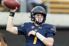 FILE - In this Dec. 1, 2018, file photo, California quarterback Chase Garbers passes during warmups before a football game in Berkeley, Calif. Garbers started 10 games as a redshirt freshman, completing 61.2 percent of his passes with 14 TDs and 10 interceptions. Garbers will likely be the man again this season although UCLA transfer Devon Modster could push him.