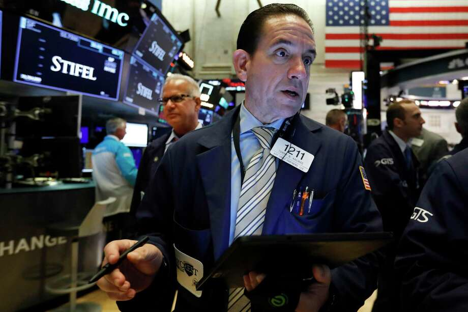 FILE - In this Aug. 6, 2019, file photo trader Tommy Kalikas works on the floor of the New York Stock Exchange. The U.S. stock market opens at 9:30 a.m. EDT on Friday, Aug. 9. (AP Photo/Richard Drew, File) Photo: Richard Drew / Associated Press / Copyright 2019 The Associated Press. All rights reserved