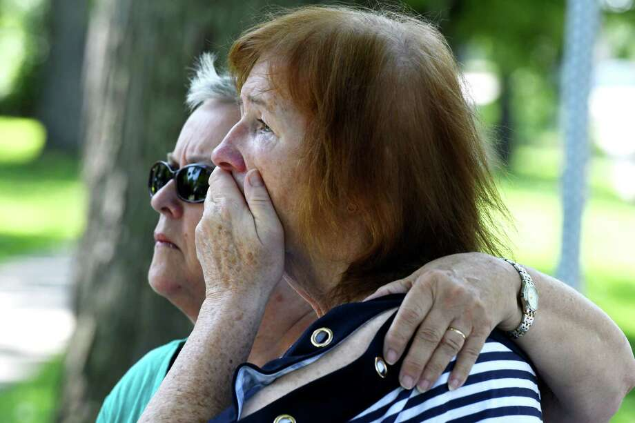 Child Victims Act sexual abuse plaintiff Susanne Robertson, right, is comforted by her cousin, Mary Slater, left, during a news conference announcing three lawsuits to be filed against the Albany Catholic Diocese on Wednesday, Aug. 14, 2019, outside the Diocese of Albany offices in Albany, N.Y. Robertson alleges she was abused at the St. Colman's Home in the 1960s. (Will Waldron/Times Union) Photo: Will Waldron, Albany Times Union / 20047653A