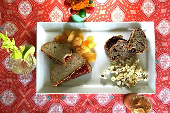 Spicy Tomato Jam and Cashew Butter Sandwich, left, with Zapp's Voodoo chips and Almond Butter and Fig Jam Sandwich with kettle corn.