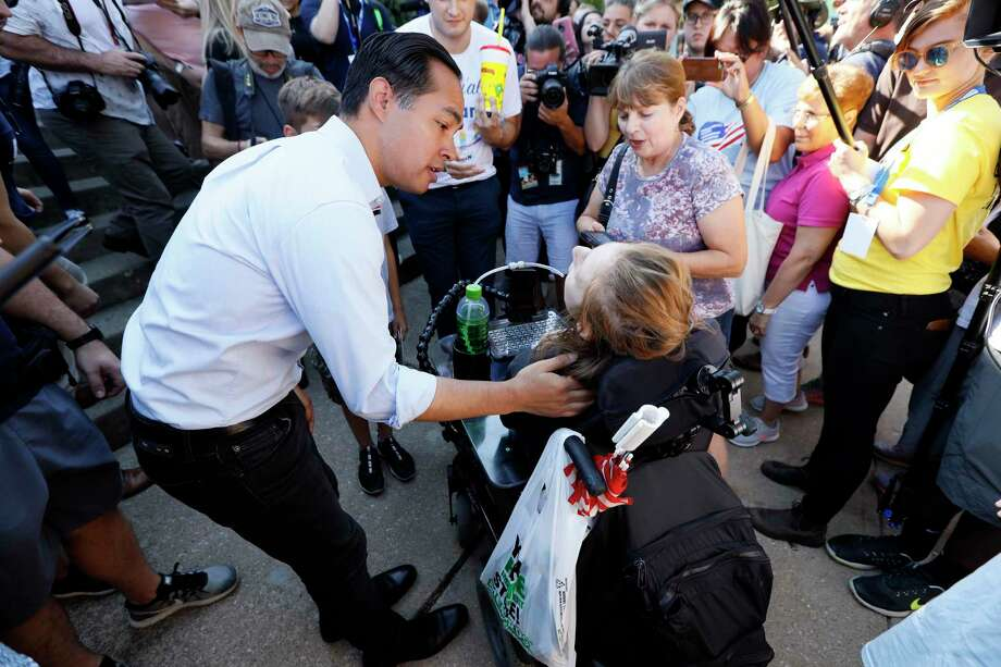 After the shootings at a Walmart in El Paso, Democratic presidential candidate  Julián Castro, here Friday with voters at the Iowa State Fair, has renewed his message, even going so far as to buy commercial air time on Donald Trump's favorite Fox morning show. Photo: Charlie Neibergall /Associated Press / Copyright 2019 The Associated Press. All rights reserved