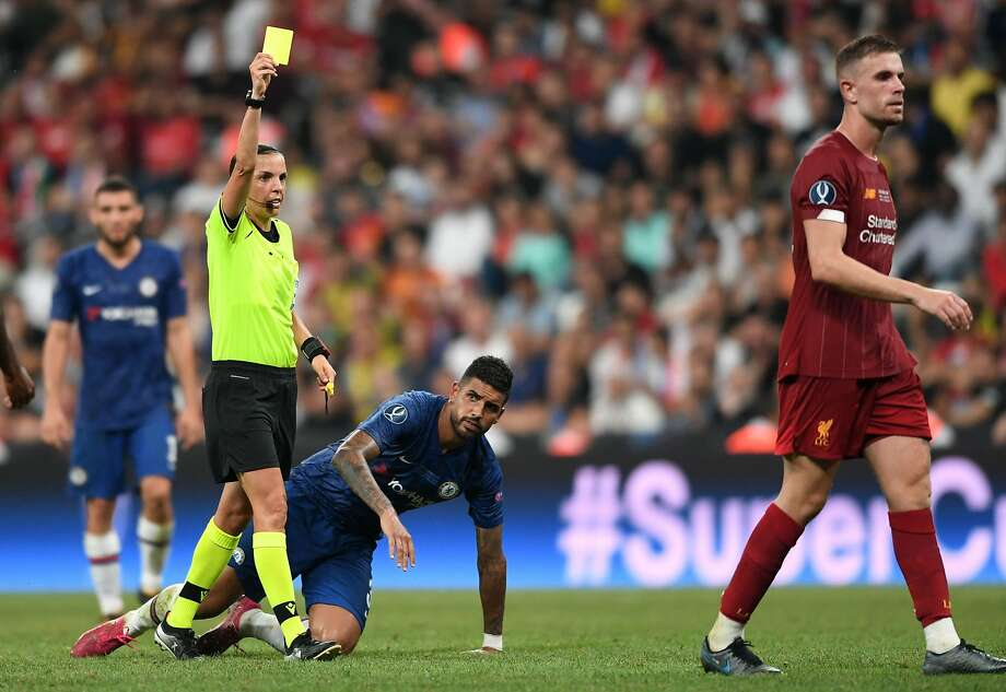 "In the highest-profile men's game yet for a female referee, Stephanie Frappart made it look like any other. A month after she oversaw the Women's World Cup final, the French ref dealt with everything in Wednesday's Super Cup game between Liverpool and Chelsea in Istanbul: star players' tantrums, soccer's tangled handball rules, and the physical test of extra time. Such was her control, her milestone presence was hardly felt. In only the sixth minute she made the crucial call not to give Liverpool a penalty when Sadio Mane's scissor-kick shot hit Andreas Christensen's arm. Frappart had few problems keeping pace with the world's top male players — a concern sometimes voiced by critics of female referees — and was quietly authoritative. Frappart kept Chelsea's players under control when they twice had goals ruled out for offside on the way to a penalty-shootout loss to Liverpool . She greeted aggrieved players with a firmly outstretched palm and faced down objections calmly, such as when Chelsea's Cesar Azpilicueta was upset to receive a booking for shoving Mane. Frappart could be jovial too, smiling and patting Chelsea's Jorginho on the back after blowing the whistle for halftime. Frappart became the first woman to referee a French top-flight men's game when she oversaw Amiens against Strasbourg in April. She has been promoted to a full-time role for the French men's league this season. She said in June she was ""proud and honored"" to gain that promotion and hoped she could inspire more young girls to take up refereeing. For the Super Cup, Frappart was accompanied by assistants Manuela Nicolosi of France and Michelle O'Neal from Ireland, reuniting the team which officiated the United States' win over the Netherlands in the Women's World Cup final last month. Photo: Ozan Kose / AFP / Getty Images"