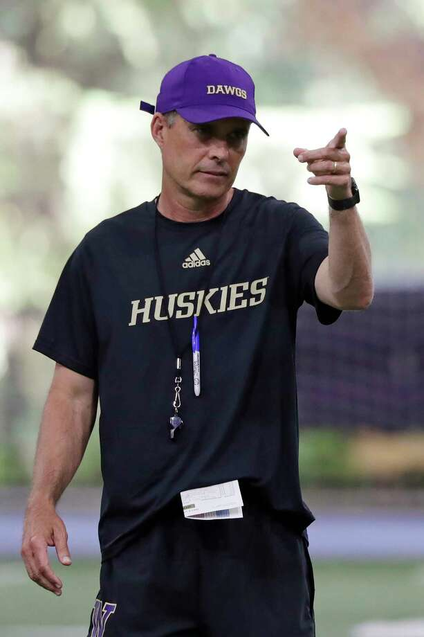 FILE - In this Aug. 5, 2019, file photo, Washington head coach Chris Petersen looks on during an NCAA football practice in Seattle. In his tenure at Washington, Chris Petersen has faced situations where the Huskies lose a significant chunk of talent to the next level, only to replenish and continue what's been an upward trend during his first five seasons in charge.  This season will test whether the Huskies can simply continue to reload. Photo: Elaine Thompson, AP / Copyright 2019 The Associated Press. All rights reserved