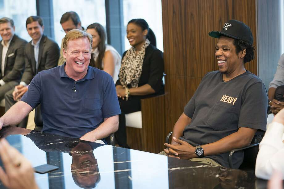 NFL commissioner Roger Goodell and Jay-Z share a laugh at Wednesday's press conference at ROC Nation in New York. Photo: Ben Hider / Associated Press