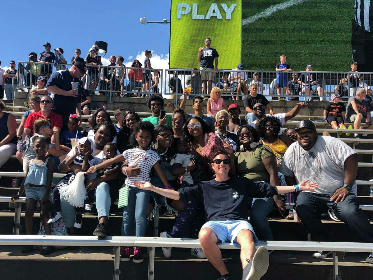 Notre Dame-West Haven grad Jeremy Longobardi, with members of the Governor's Participation Partnership, at a UConn football game last season.