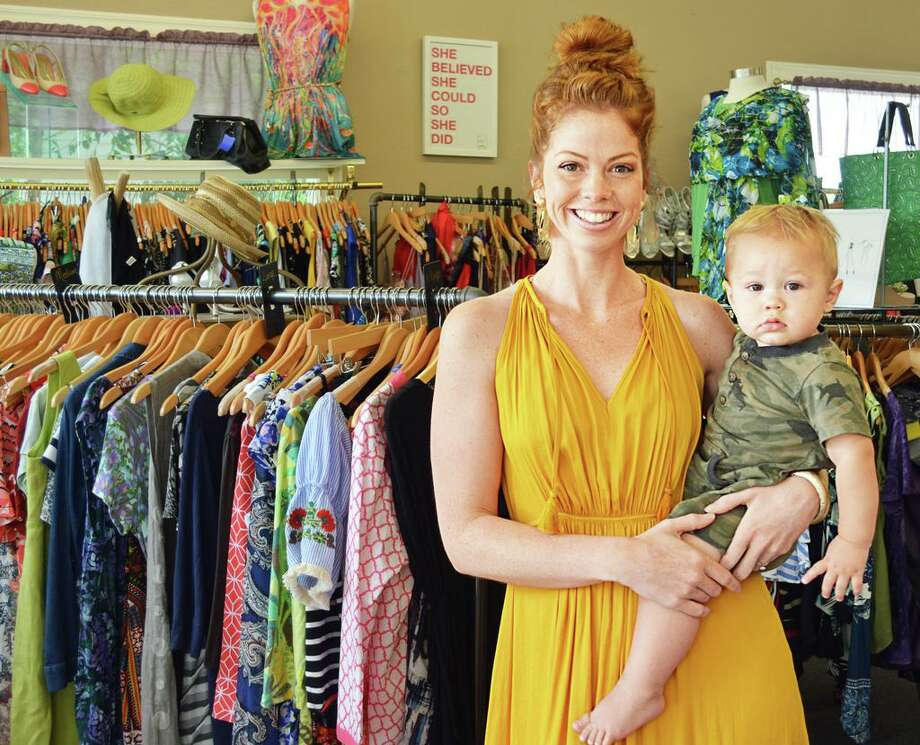 Kerianne Burchardt, shown here with her 1-year-old son Andrzej, has operated Savvy Swap Consignments at 275 Main St., Portland, for five years. She prides herself on an eclectic selection of girls and women's clothing and accessories in all sizes, all name brands. She just expanded into men's selections. Photo: Cassandra Day / Hearst Connecticut Media