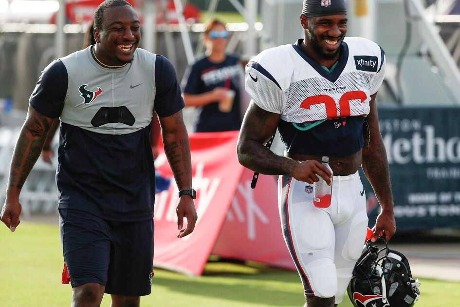 Houston Texans running backs Duke Johnson, left, and Lamar Miller (26) walk onto the practice field for a joint training camp practice with the Detroit Lions at the Houston Methodist Training Center on Houston, Wednesday, Aug. 14, 2019.